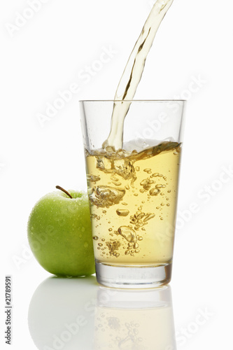 Pouring apple juice into a glass