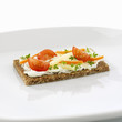 Quark with herbs and vegetable sticks on wholegrain bread