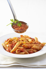 Penne all'arrabiata (Pasta with spicy sauce, Italy)