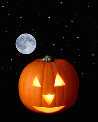 A Halloween pumpkin with moon and stars in background