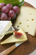 Cheese board with fig and grapes