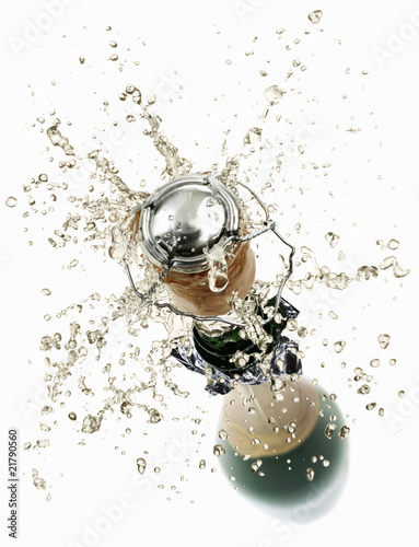 Cork flying out of a sparkling wine bottle