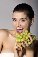 Woman with fresh green grapes