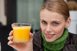 young woman with a glass of orange juice
