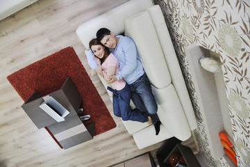 couple relax at home on sofacouple relaxing at home