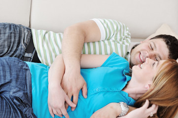 couple relax at home on sofa