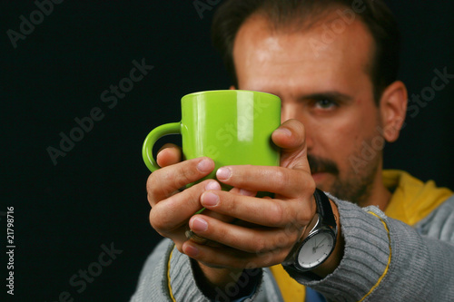 charismatic man drinking tea