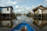 Canoeing through African village