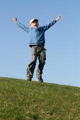 Happy kid flying on blue sky