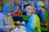 Medical team performing an operation - SURGERY IMAGES poster