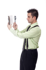 businessman reading a book with magnifying glass