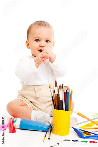 Baby boy with pencils