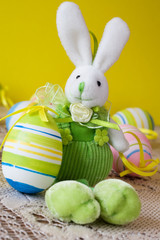cute easter bunny with colorful decorative eggs