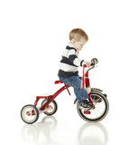 Determined Young Boy Riding Tricycle for Exercise poster