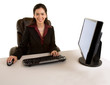 Businesswoman Sitting at her Desk and Smiling