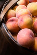 Close-up of peaches in a basket