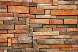 Background texture of wall with uneven sized bricks poster