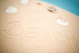 Beach handwritten in sand poster