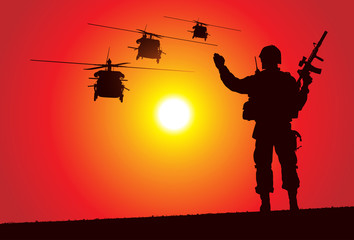 Silhouette of a soldier with helicopters on the background