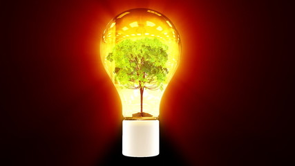 Tree growing inside flashing bulb, green energy concept