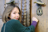 young tourist knocking on museum door poster