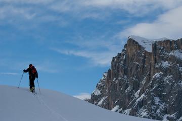 man ski hiking in swiss alps