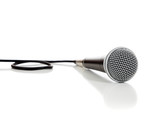 Black and silver microphone on a white background
