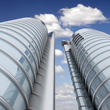 High modern skyscrapers with blue sky and clouds