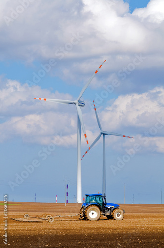 Modern agriculture, wind turbine and tractor