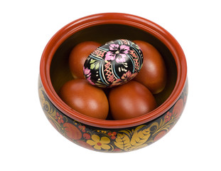 Easter eggs in Russian national bowl on a white background