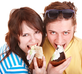 Man and girl eating cake. Isolated.