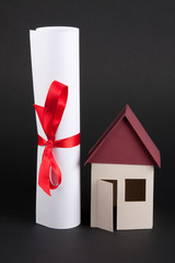 House model with sealed document