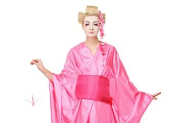 Beautiful geisha with an origami bird