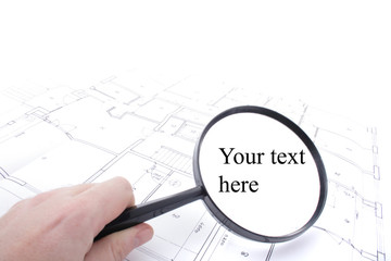 home plans and magnify glass
