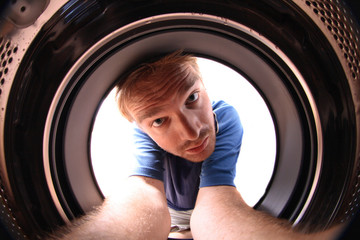 young man in wash machine