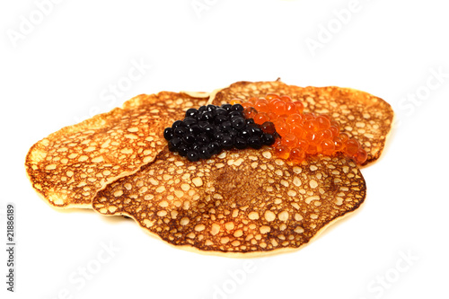 Salmon  and beluga caviar with russian pancakes