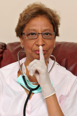 Mixed raced nurse with stethoscope