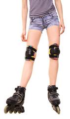 Feminine legs with roller skates