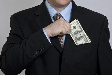 man taking hundred dollar bills out of pocket