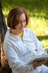 Woman reading a book outdoors