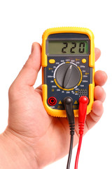 Hand with a digital multimeter on a white background