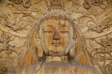 Buddha's face. Wooden statue