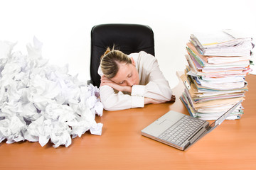 Business woman asleep at desk