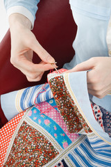 Close-up of woman's hand stitching quilting