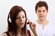 young woman with headset (with a man)