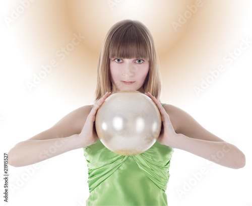 Beautiful woman with gold sphere in hand