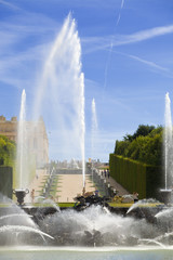 Neptune fountain spraying water in Versailles Chateau. France