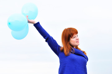 redheaded girl with balloons
