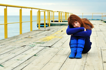 redheaded girl on a pier