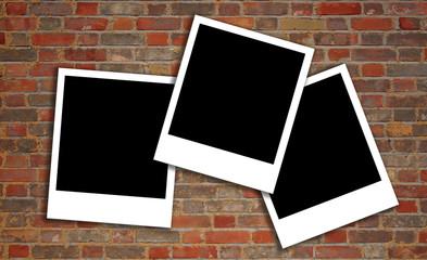 brick wall texture with polaroids